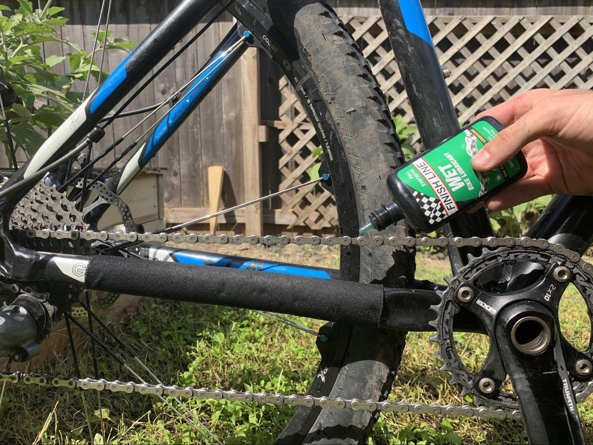 applying lube to bike chain